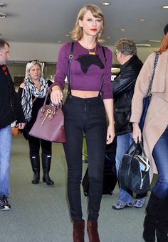 Taylor Swift Purple Horse Sweater And Dark Blue Suspenders Chic At Tokyo Narita Airport - http://oceanup.com/2014/11/08/taylor-swift-purple-horse-sweater-and-dark-blue-suspenders-chic-at-tokyo-narita-airport/