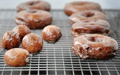 Deep fried or baked. Dipped in glaze or rolled in sugar. Topped with sprinkles or left unadorned. You'll love these glazed sour cream doughnuts. Glazed Doughnut Hole Recipe, Donut Glaze, Doughnut Holes, Donut Recipes, Dessert Recipes, Breakfast Recipes, Copycat Recipes, Dessert Ideas, Yummy Recipes