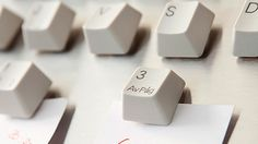 Have an old keyboard lying around? Pop off the keys and turn them into fridge message magnets with this easy DIY hack