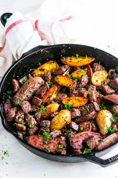Skillet Garlic Butter Steak and Potatoes - Quick and easy pan seared meal with juicy steak bites and crispy fingerling potatoes coated in a delectable garlic butter herb sauce (gluten free). From aberdeenskitchen.com. #skillet #garlic #butter #herb #steak #potatoes #glutenfree #dinner #recipe #quick #easy #onepot