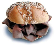 """Introducing """"Beef on Weck,"""" a Western New York favorite. Rare roast beef and jus are served on a kaiser roll crusted with salt and caraway seed. Do as the locals do, dress it with straight horseradish and take a big bite. To die for! This photo is courtesy of Anderson's Custard."""