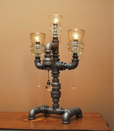 Industrial Style Pipe Lamp with 3 Glass Insulators and Pull Chain Switch. $170.00, via Etsy.