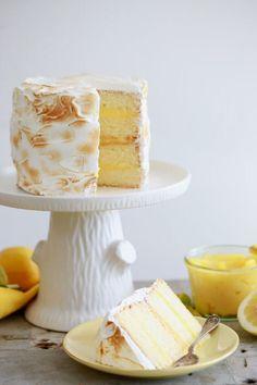 Easily make this fresh and bold Lemon Meringue Cake recipe for springtime. It features my best vanilla cake, Homemade Lemon Curd & Meringue Frosting! Lemon Meringue Cake, Meringue Frosting, Lemon Curd, Vanilla Cake, Baking Recipes, Cake Recipes, Dessert Recipes, Mini Cakes, Cupcake Cakes