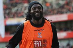 Emmanuel Adebayor is in talks with Fulham over a shock move to Craven Cottage.