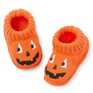 Your newborn will love these orange crocheted booties. Roll cuff keeps these booties on your little pumpkin's feet!  #CartersHalloween