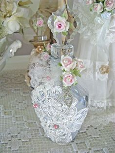 pretty bottle with lace and roses