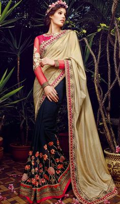 Take your graceful styles up a few notches arrayed in this navy blue and beige embroidered chiffon georgette half n half sari. The fantastic attire creates a dramatic canvas with wonderful lace, moti and resham work. #LovelyDesignTrendsetterSaree