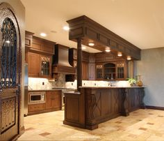 Basement Kitchen perfect for entertaining... custom detail design on back of cabinets