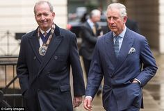 The royal looked smart in a blue pinstriped suit as he headed into the Guild