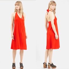 Topshop Halter V-Neck Midi Dress A halter bodice with a plunging neckline elegantly flows into a flippy A-line skirt to give this midi dress a swingy, summer-ready silhouette. Brand new with tag! Topshop Dresses Midi