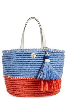 Whether at the beach or on the go, this straw tote bag from Tory Burch would be the perfect accessory! It features bold color blocking, lush tassels, and spacious interior with plenty of pockets.