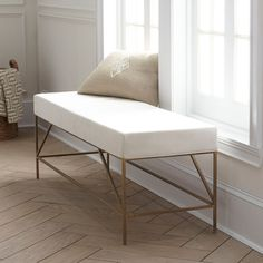 Sometimes glamour comes from simplicity. Our Modern Brass Upholstered Bench is a perfect example of that. It features a comfortably soft upholstered cotton seat in crisp white and brass legs that will vary a bit in coloration due to the fact that they are finished by hand. It's size makes it just right at the end of a bed.