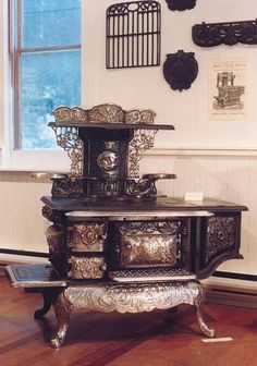 An 1890 Happy Thought stove. THAT was style! OMG I would love this in my kitchen!