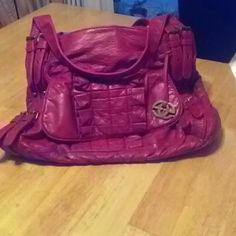 Purse Soft leather. Like new one inside zip pocket .13 inches long 16 inches wide. In my picture it looks pink but it is a true red. red by merce eck Bags Shoulder Bags