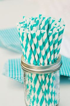 turquoise striped straws | Riverland Studios #wedding. Serve drinks in mason jars with these adorable straws.