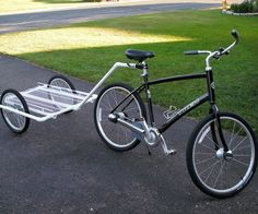 """This is fashioned after the bamboo bike trailer, with the addition of a seatpost mount and PVC instead of bamboo. I used the instruction for the wheel mounts, something I need to modify in the future to accomodate heavier loads to relieve axel flex. The PVC is 1"""" and the trailer bed is 12"""" wire shelving left over from a home remodel. The wheels are 20"""" front wheels with bolt-on axel. These are about $24 a piece unless you run a bike shop..hint,hint. The seatpost mount is made b..."""