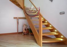 Elegant Oak Staircase with oak stringers and steps. Glass railing with round oak handrail. Led lights on stringers to add an exclusive touch of class. Iroko, mahogany, walnut are possible alternative wood choices. Dark Staircase, Luxury Staircase, Timber Staircase, Winding Staircase, Wood Stairs, House Stairs, Staircase Design, Big Design, Modern Design