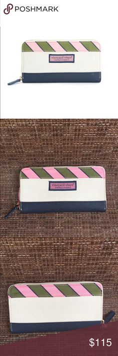 Vineyard Vines Zip Around Wallet Vineyard Vines Zip Around Wallet.  New with tags.  Gorgeous canvas wallet with navy leather and green and pink stripes.  Plenty of room for cards inside with a plaid print.  Take a look at my closet for the matching tote for the set.  This print is Sold Out! Vineyard Vines Bags Wallets
