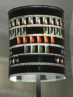 Film Negative Lamp Shade.. I don't think I'd leave any blacked out frames - too dark