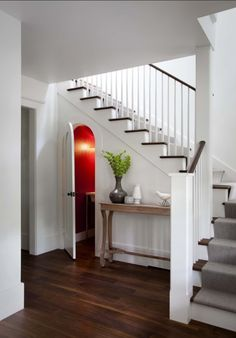 rounded door on water closet storage under stairs