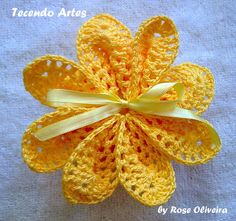 crochet flower with ribbon bow                                                                                                                                                                                 Mais
