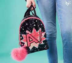 All the sparkle she can carry in a mini backpack. And look at that cute pompom!