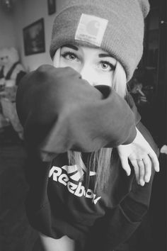 black and white blonde in beanie