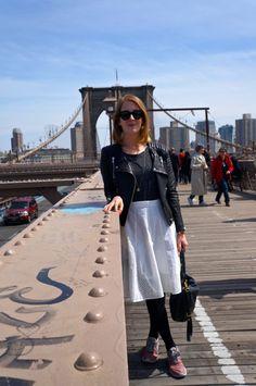 On the Brooklyn Bridge wearing a Club Monaco skirt, H&M leather jacket, Nike Roshe Run sneakers and Céline sunglasses