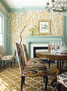 Center an eclectic and sophisticated dining room with a large, bold ikat fabric.