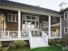 The generous front porch of a Shingle-style Hamptons beach house