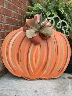Items similar to Wood Pumpkin Door Hanger on Etsy Diy Halloween Decorations, Thanksgiving Decorations, Fall Decorations, Thanksgiving Projects, Fall Projects, Halloween Projects, Wood Pumpkins, Fall Pumpkins, Autumn Decorating