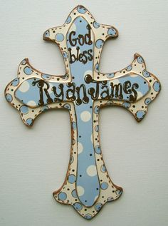 Hand painted personalized baby boys room wooden cross wall decor. $35.00, via Etsy.
