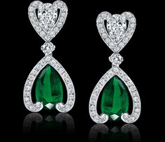 Pear-shaped, 3.11 and 3.12 carat emerald, diamond and platinum earrings. Regal Collections Garrard