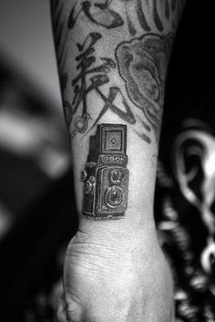land camera tattoo
