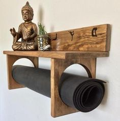 YogaWares makes specialty yoga mat holders for you or your favorite yogi. Made entirely of real wood, hand stained and decorated with white vinyl. A large full size shelf at the top to place your meditation or decorative items and custom Decor, Wood, Diy Furniture, Woodworking, Yoga Room, Home Decor, Meditation Rooms, Zen Room, Yoga Mat Holder
