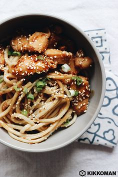 Teriyaki Chicken with Noodles | Noodles are tasty, quick to cook, and so much fun to eat! Fill your favorite bowl with yummy udon, swirl them around in a mix of Kikkoman®️️ Soy Sauce, Kikkoman®️️ Sesame Oil, Kikkoman®️️ Rice Vinegar, honey or agave, and canola oil, then sprinkle with sesame seeds. Top it all off with pieces of skillet-fried chicken breast marinated in Kikkoman®️️ Teriyaki Marinade & Sauce for a quick and easy dinner! | Huge thanks to @maia