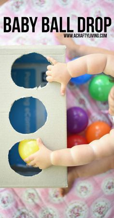 Easy Baby Play - DIY Baby Ball Drop with a Cardboard Box! http://www.acraftyliving.com