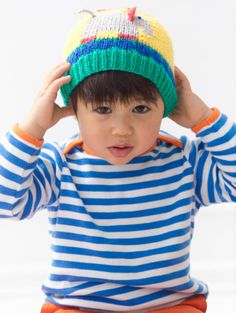 Knit this circus themed hat made with Modern Baby for your favorite clown.