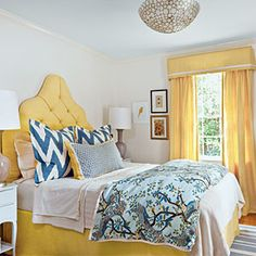 Decorate with Yellow | Draw inspiration from a favorite fabric when selecting wall paint. A classic palette of blue and yellow gives this bedroom a punchy modern update. | SouthernLiving.com