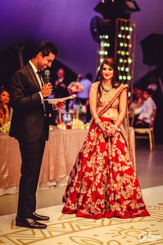 Groom reading out vows to his bride 💓 . Sangeet Lehengas - Crimson Red Bridal Lehenga with Floral Zardozi Gold Embroidery, Gold Blouse Indian Bridal Outfits, Indian Bridal Wear, Pakistani Outfits, Indian Dresses, Bridal Dresses, Indian Clothes, Gold Lehenga, Bridal Lehenga, Lehenga Jewellery