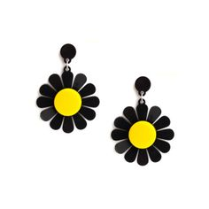 Description Celebrate the arrival of spring with the electric coloured daisy earrings. Bold blooms are laser cut in thick black and yellow perspex that will brighten up your look in an instant. Pair with a patterned dress for a total flower power look.  Measurement 7x9 cm of each *The earring can be made with either silver plated pins or silver plated clip on if you do not have pierced ears. Please specify when ordering.