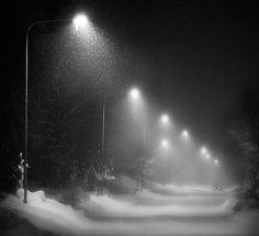 Snow quietly falling at night through streetlights. This photo makes me wish for snow. My favorite thing is to sit on the porch with my hubby and watch the snow fall at night and cover the streets and grass. It can be so silent outside one would say you could hear the snow fall....