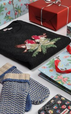 Cosy Christmas gifts, with novelty jumpers mittens and scarves