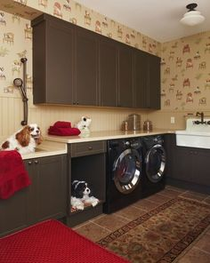 One look at these dogs' faces and it's clear that this laundry room is a hit. Plus, the dog-patterned wallpaper by Thibaut is a nice touch.