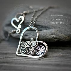 All sterling silver one of a kind heart filigree necklace. The chain finished with a heart shaped hand forged clasp can be worn without the pendant