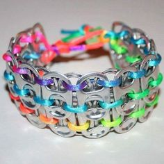 Rainbow pop can tab cuff bracelet. After drinking soda from aluminum cans, you can recycle your soda cans to create interesting projects instead of tossing the empty cans into the garbage or recycling bin. Soda Tab Crafts, Can Tab Crafts, Aluminum Can Crafts, Crafts To Make, Aluminum Cans, Diy Crafts, Recycled Crafts, Soda Can Bracelet, Cola Dose