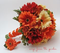 Autumn Wedding Bridal Bouquet. I found the orange and champagne daisies at Michaels. These will be added to the bouquet :).
