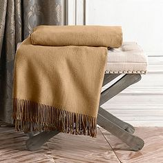A cozy throw is a perfect wedding registry gift to ensure cozy date nights!