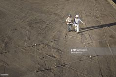 Stock Photo : Construction workers outlining construction site