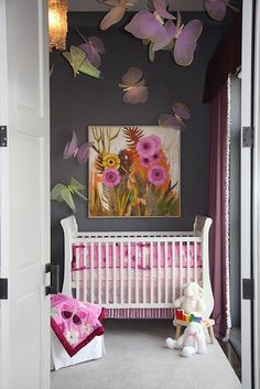 love this, such an unconventional wall color for a nursery, the accent colors  & butterflies make it fun & whimsical, while the painting above the crib keeps it all looking quite chic